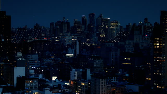 New York City Nights Night view of the city from SoHo towards Brooklyn in New York City. manhattan bridge stock videos & royalty-free footage