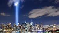 """istock New York City – September 11th """"Tribute In Light"""" Time-lapse From Brooklyn Heights 1282537319"""