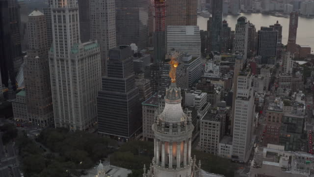 AERIAL: New York City Skyscrapers close up with golden statue in beautiful 4K AERIAL: New York City Skyscrapers close up with golden statue in beautiful 4K suspension bridge stock videos & royalty-free footage