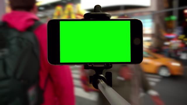 New York City Time Square selfie stick crowd green screen chromakey video