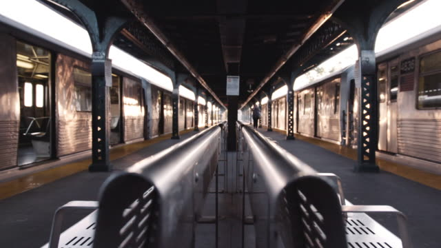 New York subway platform. A symmetrical, hand-held shot looks down the center of an empty Brooklyn subway platform. station stock videos & royalty-free footage