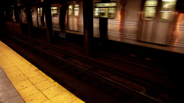 New York subway train arrives to the station platform video
