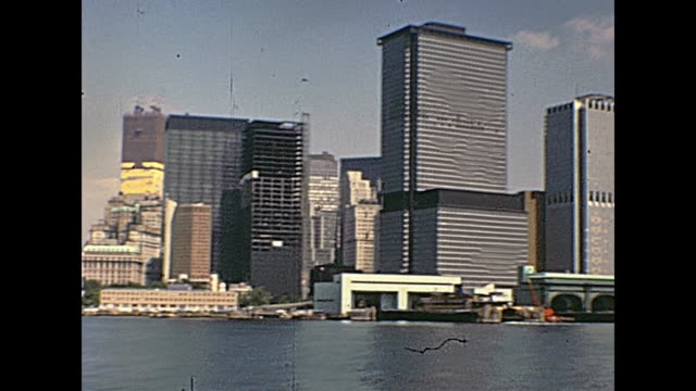 WTC New York Manhattan World Trade Center skyline on seventy. Twin Towers under construction site, from the boat tour on Hudson river. New York, United States of America on 1970. 20th century stock videos & royalty-free footage