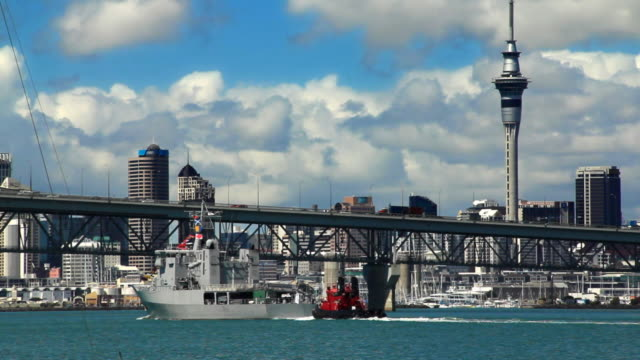 New Zealand: Auckland city and Harbour Bridge with Navy vessel. video