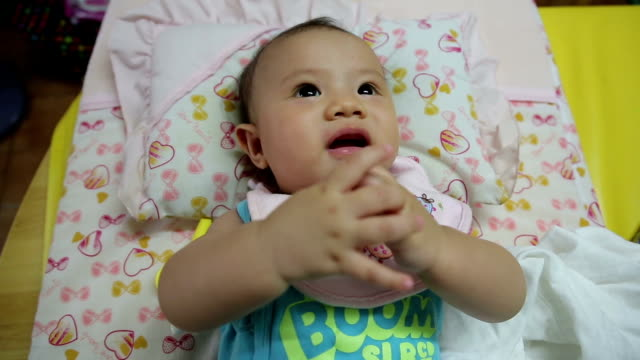 newborn baby playing on the bed video