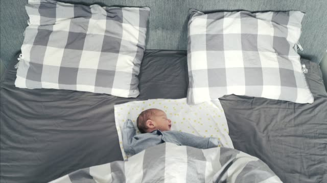 Newborn child sleeping. Newborn child sleeping in the middle of the day. double bed stock videos & royalty-free footage