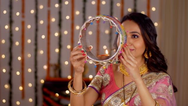 newly wed couple celebrating their first karwa chauth together - indian festival - sari filmów i materiałów b-roll