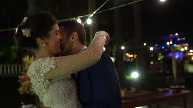 Newlywed couple dancing under the lights Newlywed couple dancing under the lights newlywed stock videos & royalty-free footage