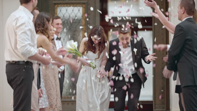 SLO MO Newlyweds being showered with petals when leaving church video
