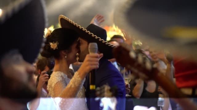 Newlyweds dancing mexican music during party