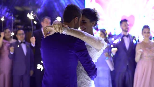 Newlyweds dancing waltz on the dance floor