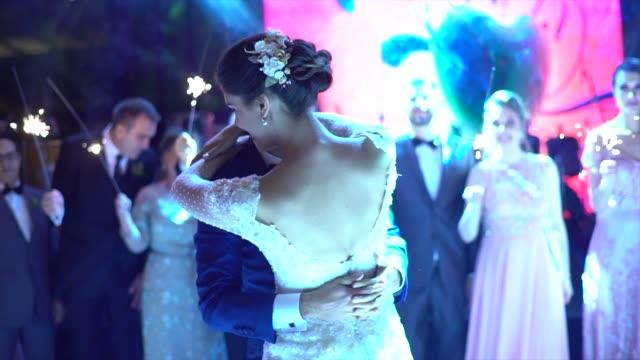 Newlyweds dancing waltz on the dance floor Newlyweds dancing waltz on the dance floor newlywed stock videos & royalty-free footage
