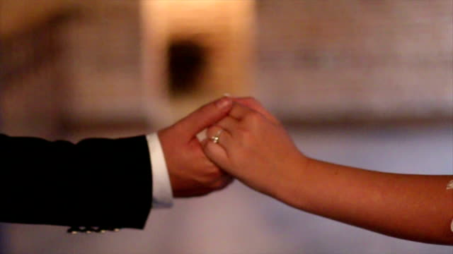 Newlyweds hold hands video