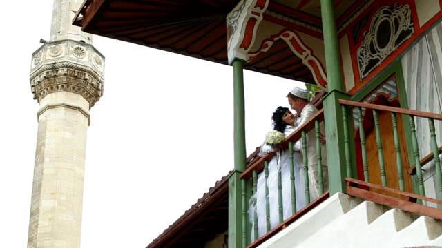newlyweds on  steps of  mosque after Nikah video