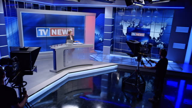 CS News studio with the anchorwoman presenting the news video