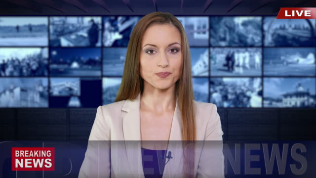 Newscaster Reading The Breaking News Newscaster Reading The Breaking News breaking stock videos & royalty-free footage
