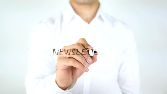 newsletter, man writing on glass - newsletter video stock e b–roll