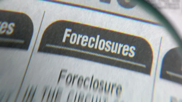 newspaper foreclosures - foreclosure stock videos & royalty-free footage