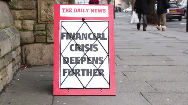 Newspaper Headline board - Financial crisis deepens further video