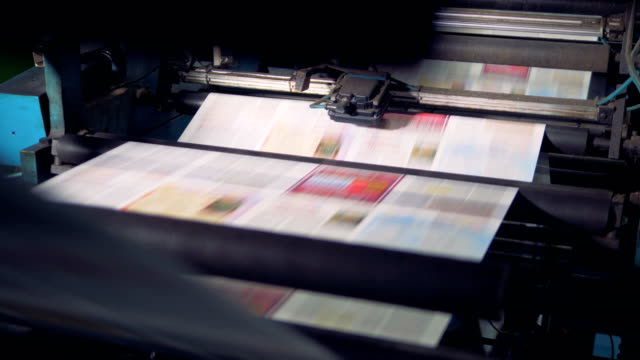 newspaper printed on a printing house machine. - newspaper paper video stock e b–roll