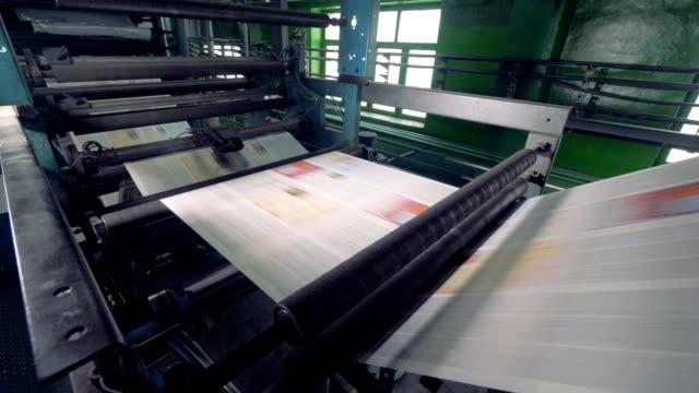 Newspaper printing equipment working. 4K.