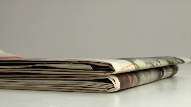 Newspapers (HD,NTSC) Newspapers being stacked one by one. heap stock videos & royalty-free footage
