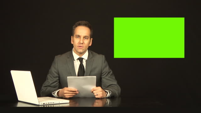 Newsreader Or TV Reporter Reading The News With Green Screen Video