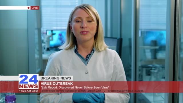 vídeos de stock, filmes e b-roll de notícias-jovem doutor da vida do médico que relata de um laboratório - história