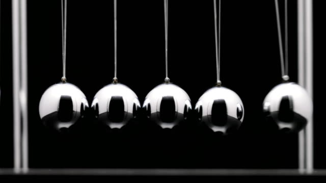 newton cradle with swinging metal balls in slow motion - stimulus stock videos & royalty-free footage