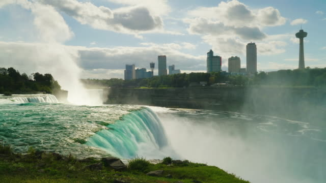 Niagara Falls, can be seen the Canadian coast and silhouettes of buildings on the other side of the Niagara River video