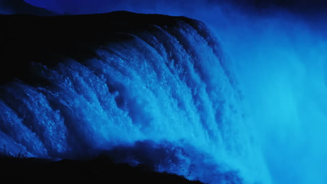 Niagara Falls with night illumination. Lighted in blue light. 4k slow motion video video