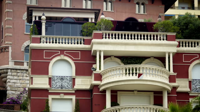 Nice balconies of expensive apartment house, luxury property, establishing shot Nice balconies of expensive apartment house, luxury property, establishing shot french architecture stock videos & royalty-free footage