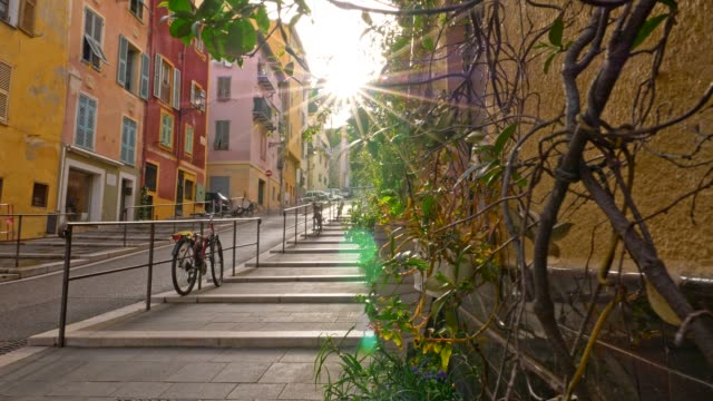 Nice, France. Gimbal sunrise shot of street  with color houses in old town of Nice, France. 4K