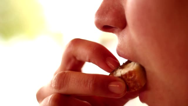 Nice girl eating truffles with bread Nice girl eating truffles with bread snack stock videos & royalty-free footage