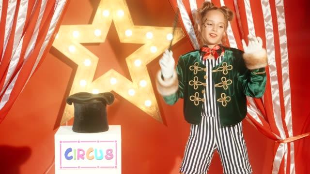 a nice young girl shows magic trick - предподростковый возраст стоковые видео и кадры b-roll