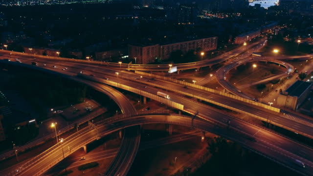 Night aerial view of a freeway intersection highways Night aerial view of a freeway intersection highways treedeo speed way stock videos & royalty-free footage
