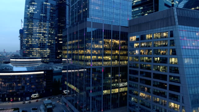 night aerial view of skyscrapers. business concept. - edificio adibito a uffici video stock e b–roll