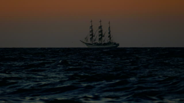 night and silhouette of an old sailboat