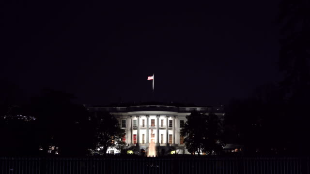 Night Architecture of White house in Washington DC with US Flag, District of Columbia USA