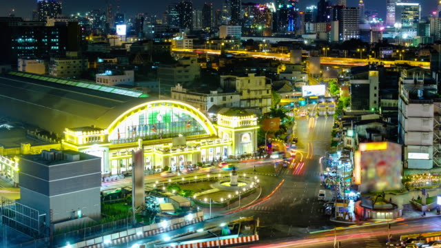 Night city of Bangkok railway station building in front of traffic located in Bangkok Thailand