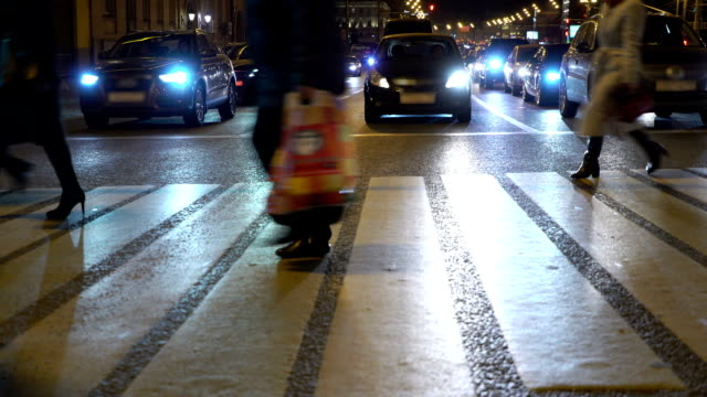Night City. People crossing street. Crowded crosswalk. City life video
