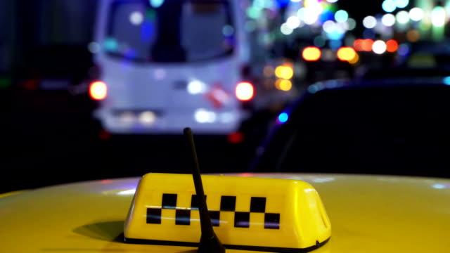 Night City Traffic. Ambulance With Emergency Lights to Rescue. Sighn Taxi Cab