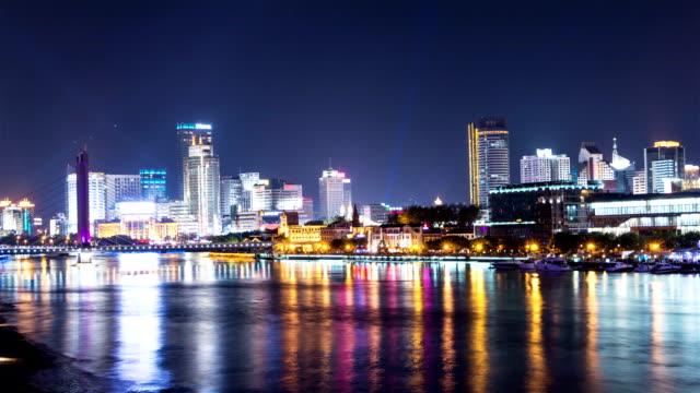 night cityscape at riverside,timelapse. video