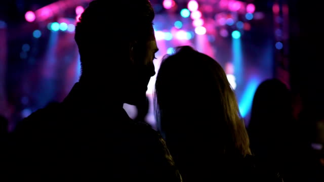 Night club atmosphere, loving couple dancing and laughing at music festival video
