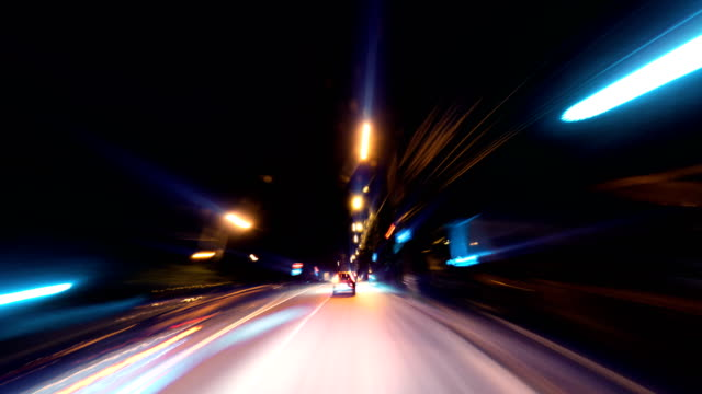 Night driving of a car in a metropolis through the streets and roads of the city