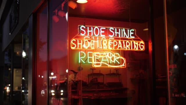 Night Establishing Shot of Neon Sign at Shoe Repair Store video