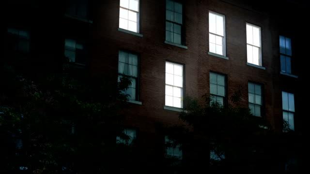 Night Establishing Shot of Office Building Lights Turning On – film