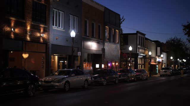 night establishing shot of typical american small town main street - dusk stock videos & royalty-free footage