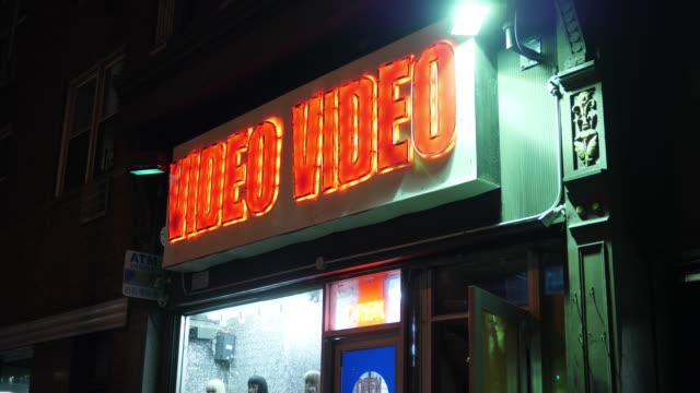 Night Establishing Shot of Video Store in Big City video