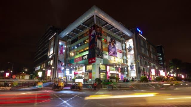 night illuminated bangalore city famous shopping mall front traffic crossroad panorama 4k timelapse india - india video stock e b–roll